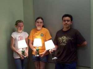 Youth holding can lamps made at the 4-H Electric Workshop