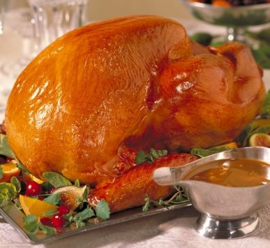 A large cooked turkey on a table