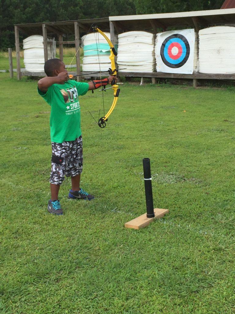 child practicing archery