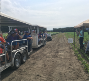 people on a farm tour