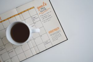 mug of coffee and goals calendar