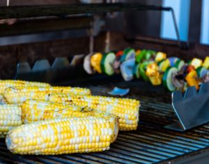 corn and vegetables on grill