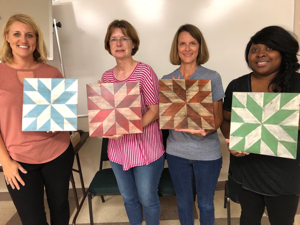 4 ladies with painted barn squares