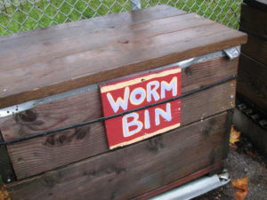 wooden box with words worm bin