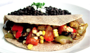 vegetable taco with side of beans