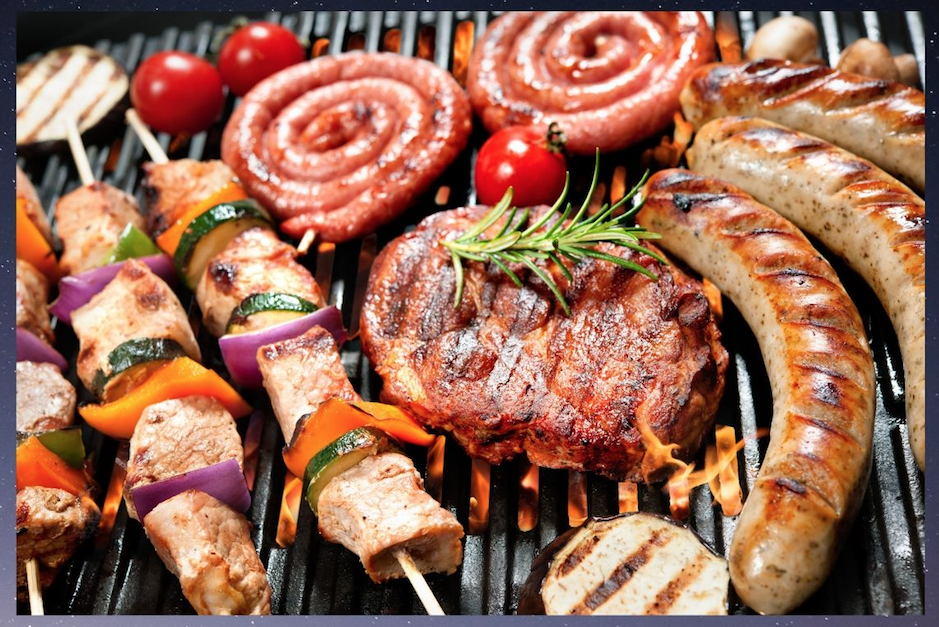 sausages, steak, veggies over grill flame