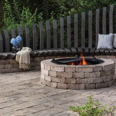 concrete pavers & lit fire pit on patio