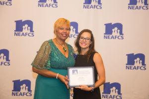 Olivia Patchel receiving award