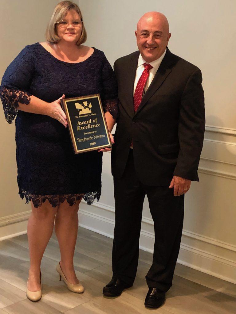 Stephanie Minton holding award with Dr. Bonanno