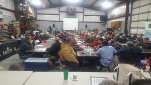 people sitting at tables attending AG meeting