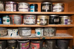 cans of old paint and chemicals