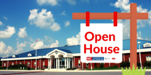 Extension office with open house sign