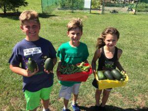 kids holding vegetables