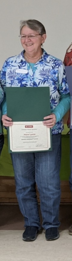pic of Joyce Lyons holding certificate