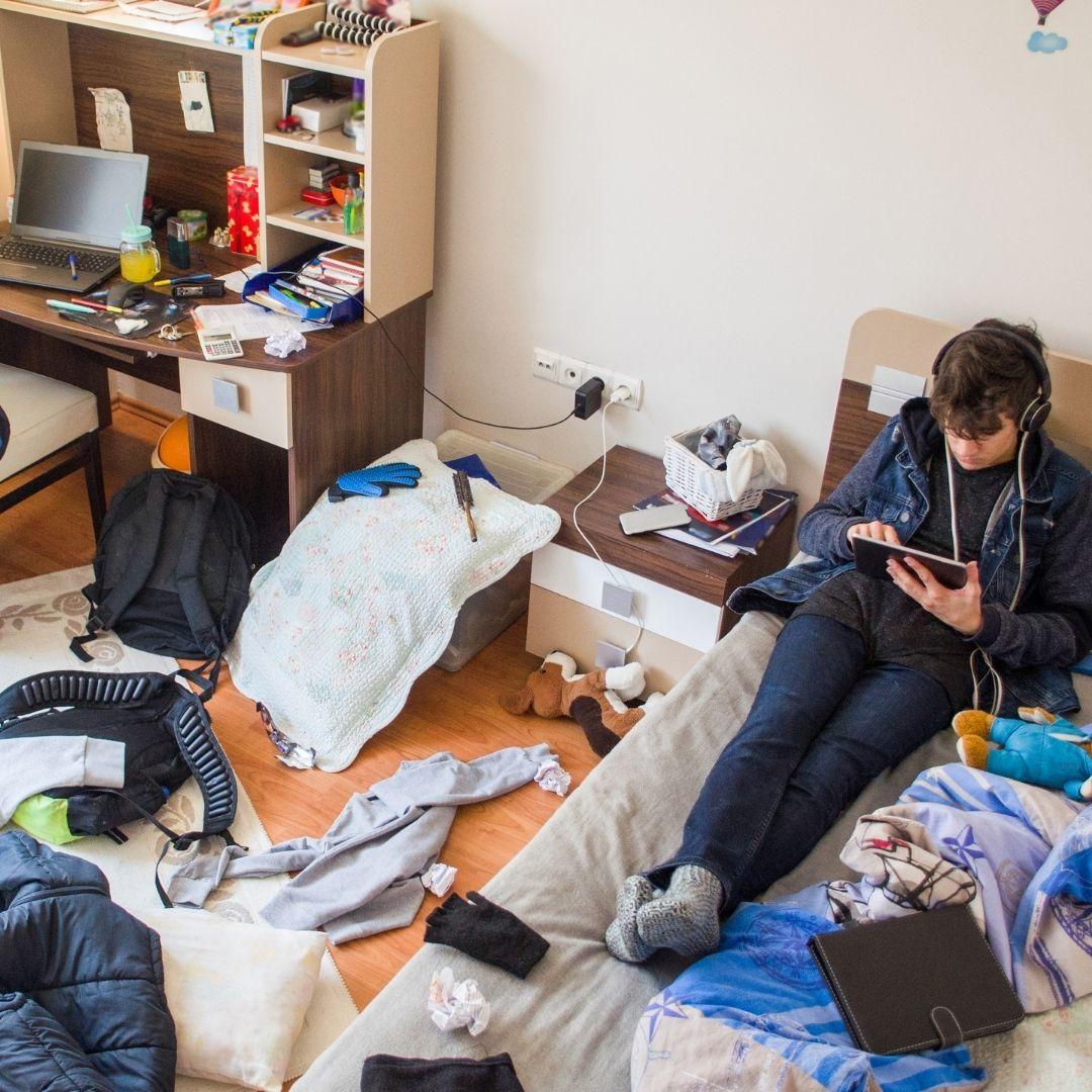 teenage in messy bedroom