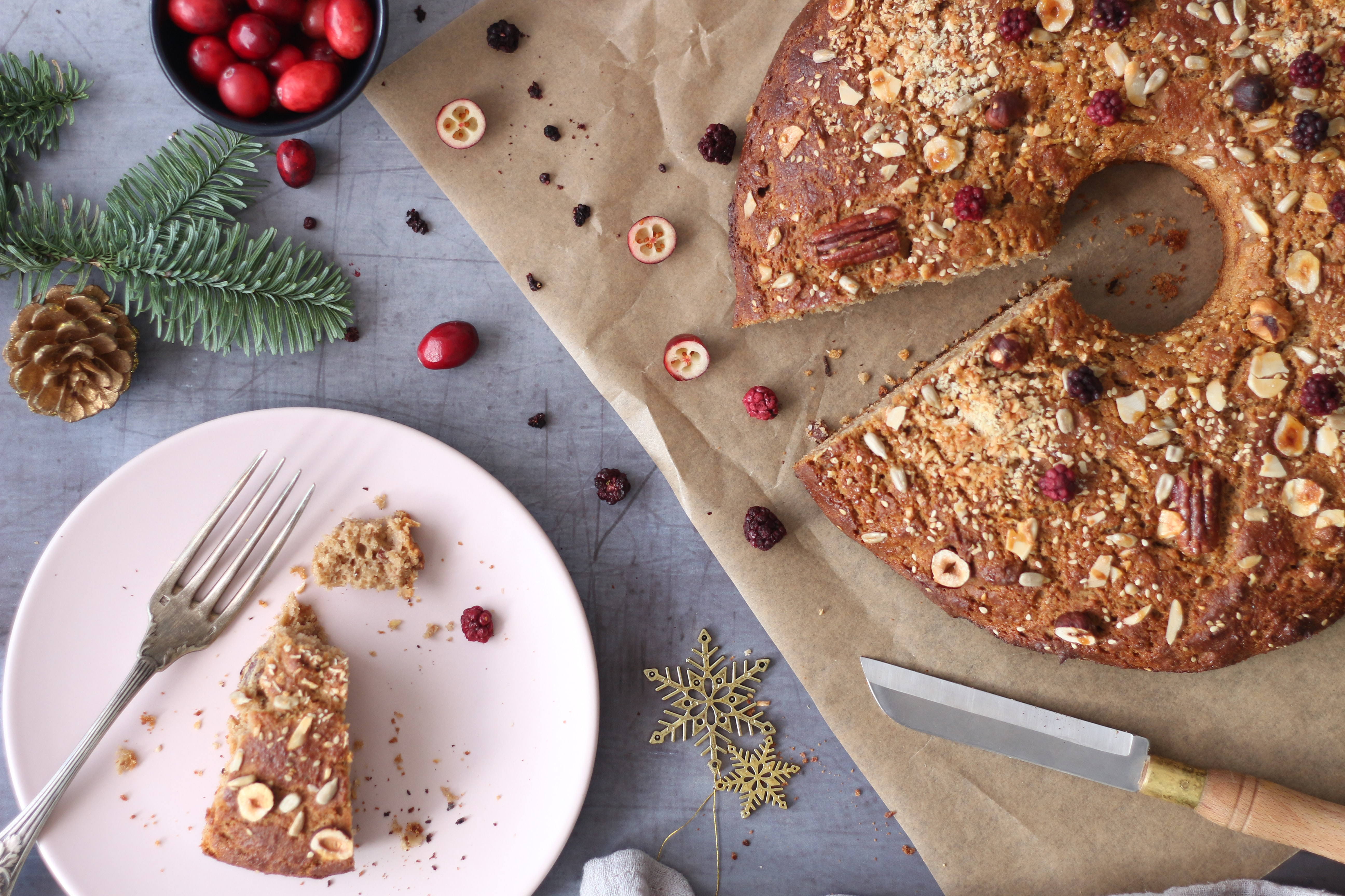 holiday cranberry cake and slice on plate