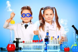 two kids doing science experiments