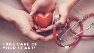 red heart in hands with stethoscope