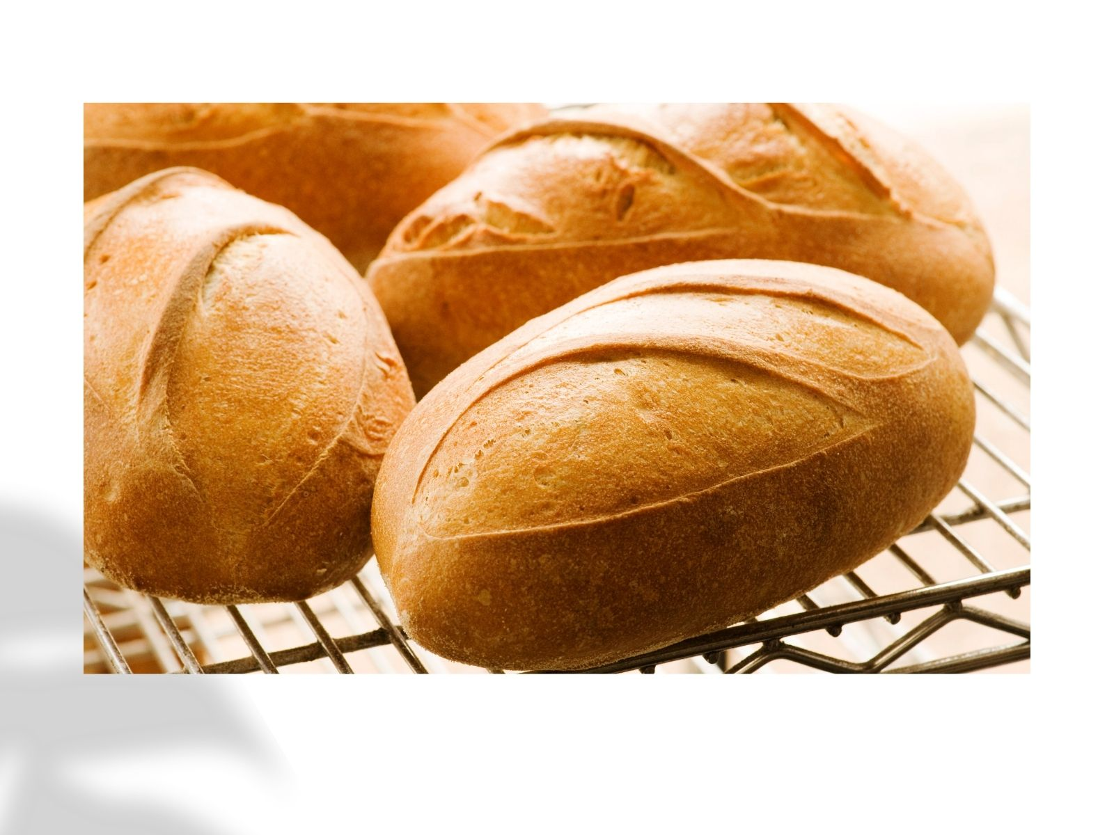 loaves of fresh baked bread on rack