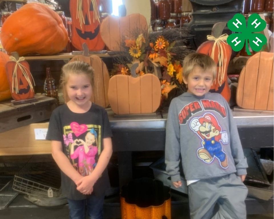 two kids with pumpkins