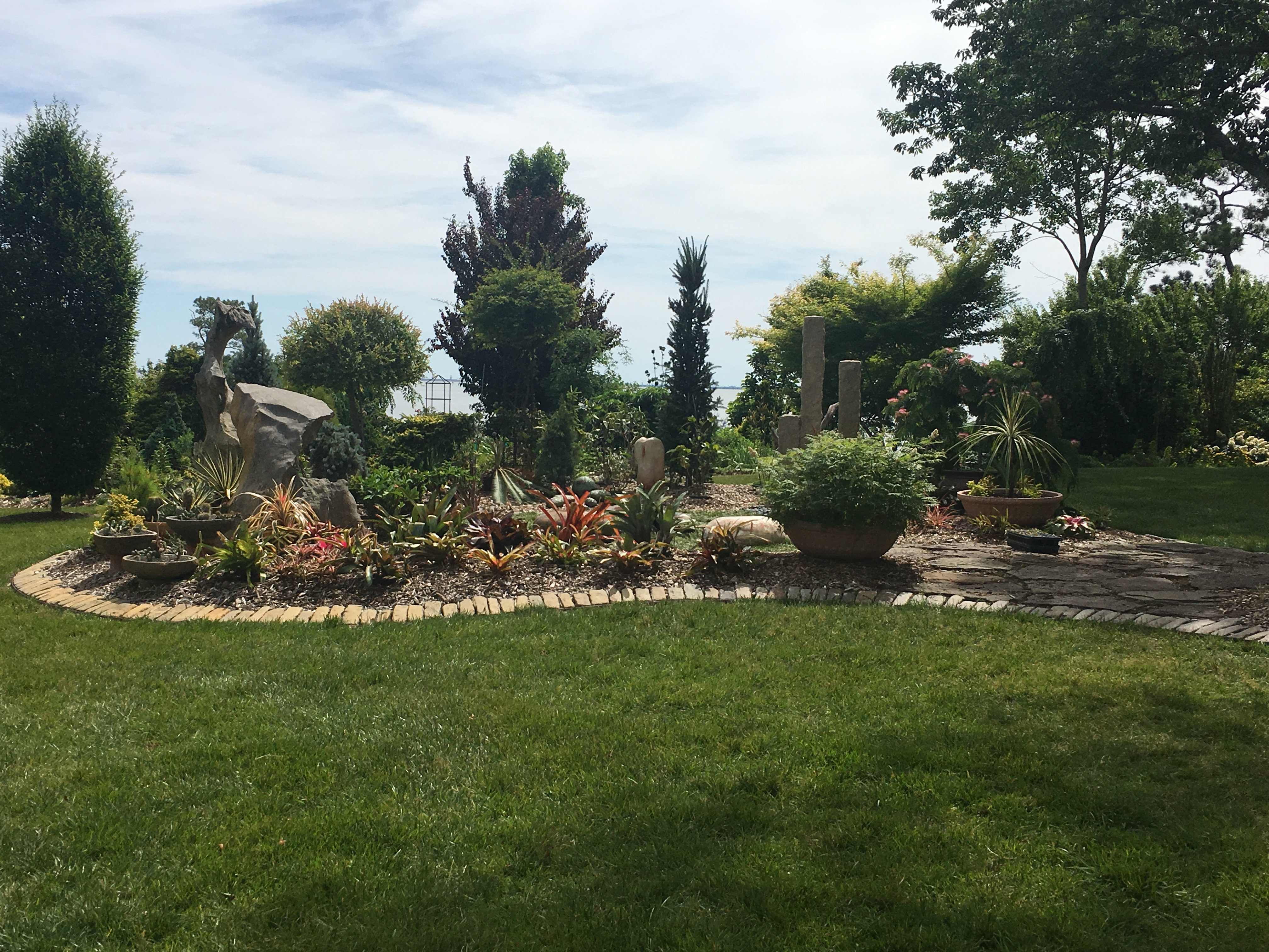 landscaped yard with plants and hardscaping