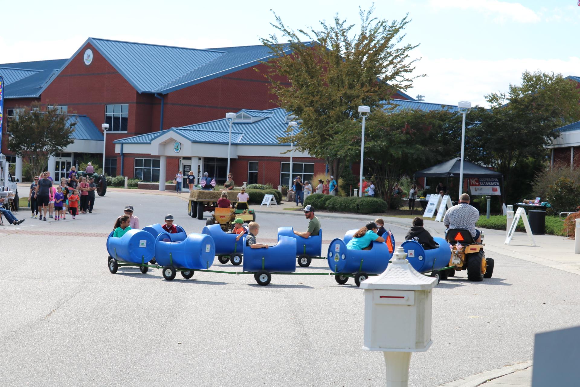lawn tractor pulling barrel cars